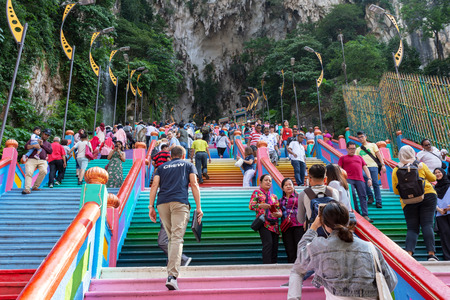 Kuala Lumpur, Malaysia - September 23, 2018: Crowd of people visiting the Batu Caves, a Hinduism temple located in Kuala Lumpur.