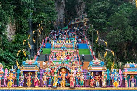 Kuala Lumpur, Malaysia - September 23, 2018: Crowd of people visiting the Batu Caves, a Hinduism temple located in Kuala Lumpur.