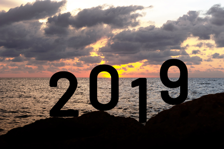 New Year Concept with number 2019 sunset background. Imagens