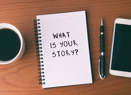 Inspirational and Motivational Quote - What is Your Story. Written on Note Pad.