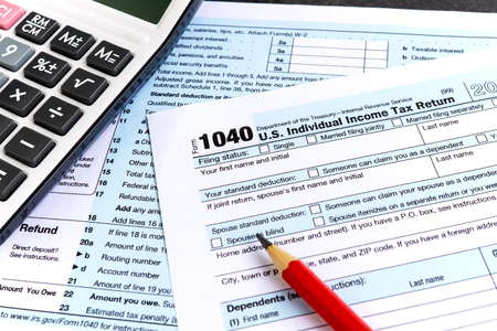 United States federal income tax return IRS 1040 documents and calculator