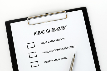 Audit Checklist on attached on Clip board and pen on white background Stok Fotoğraf
