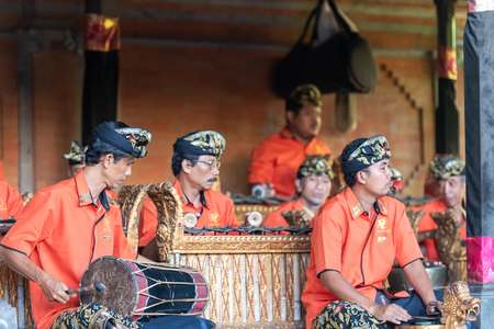 Denpasar, Indonesia - March 30, 2019: Musicians during in Barong dance performance, Balinese traditional dancing.