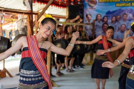 Beautiful young girls from Kota Belud Kadazan Dusun ethnic performed traditional dance during state level Harvest Festival in KDCA, Kota Kinabalu, Sabah Malaysia. Stock Photo