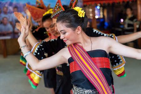 Beautiful young girls from Kota Belud Kadazan Dusun ethnic performed traditional dance during state level Harvest Festival in KDCA, Kota Kinabalu, Sabah Malaysia.