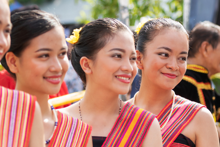 Portraits of Kadazan Dusun young girls in traditional attire from Kota Belud district during state level Harvest Festival in KDCA, Kota Kinabalu, Sabah Malaysia - selective focus.
