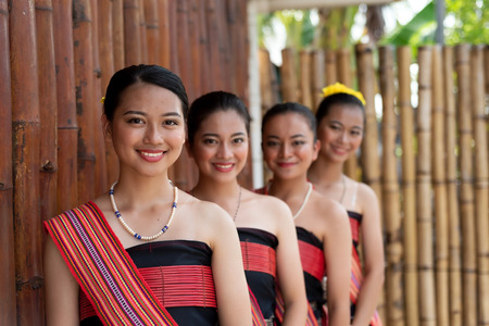 Portraits of Kadazan Dusun young girls in traditional attire from Kota Belud district during state level Harvest Festival in KDCA, Kota Kinabalu, Sabah Malaysia - selective focus. Stock Photo