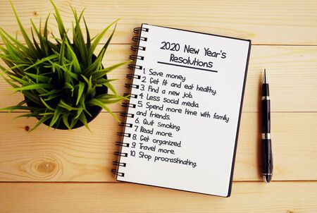 2020 New Year's Resolutions text on note pad