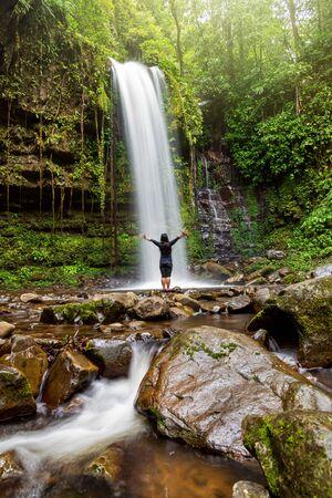 Unidentified Woman Standing at Mahua Waterfall in Crocker Range National Park Tambunan Sabah Borneo Malaysia 写真素材