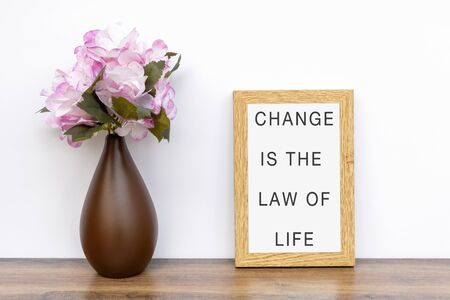 Change is the law of life - Inspiration quotes on wooden frame. Фото со стока
