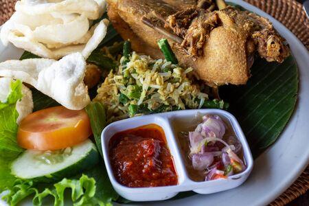 Nasi Campur Bali Bebek Betutu translate Balinese Mixed Duck Rice, Indonesian Balinese cuisine. Stock Photo