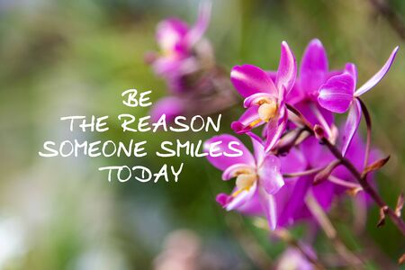 Motivation and inspirational quotes - Be the reason someone smiles today. Blurry background. Imagens