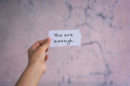 Motivation and inspirational quotes - You are enough. Blurry background. Imagens