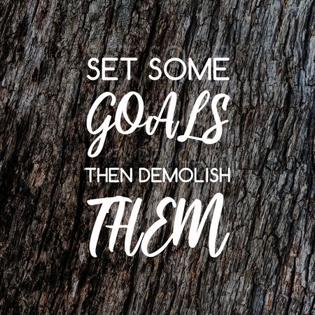 Motivation and inspirational quotes - Set some goals the demolish them. Blurry background. Imagens