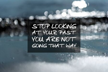 Motivation and inspirational quotes - Stop looking at your past you are not going that way. Blurry background. Imagens