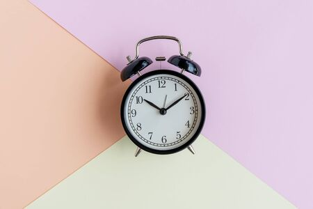 Alarm clock on pastel background - still life conceptual