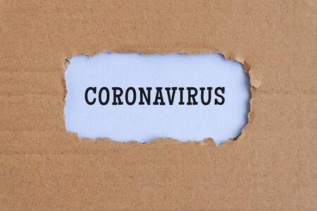 Coronavirus text on torn paper - health concept. Imagens