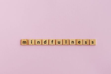 Mindfulness text wood blocks. Pink background. Imagens - 139892420