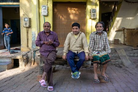 New Delhi, India - March 03, 2018:  Indian men sitting outside their house in a village in New Delhi Imagens - 140919555