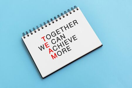 Inspirational quotes text on note pad - Together we can achieve more. Team and leadership concept