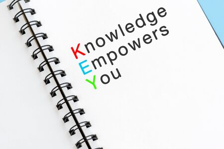 KEY acronym - Knowledge empowers you Text on note pad. Imagens