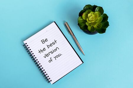 Inspirational quotes text on note pad - Be the best version of you.
