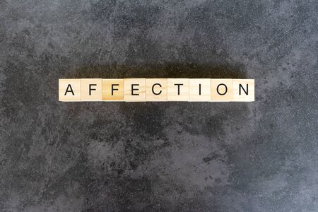 Affection text on wooden block on black texture background Imagens - 139892429