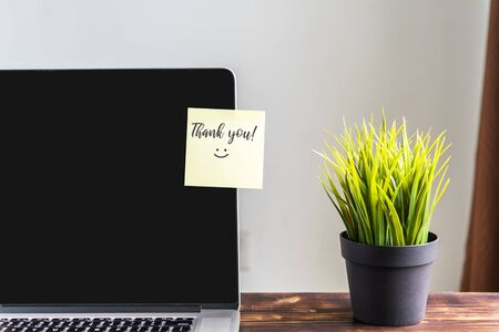 Thank you note on laptop screen, natural light. Imagens - 139892431
