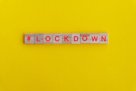 Lock down word on wooden block - Coronavirus Covid - 19 concept Imagens - 144566438