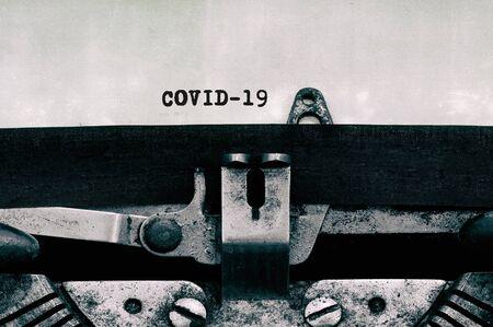 Covid-19 text on vintage typewriter