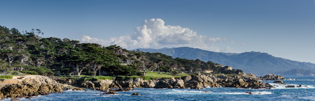 Large panoramic view of Coastline along the 17 Mile Drive in Pebble Beach of  Monterey Peninsula. California.