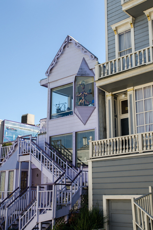 transom: SAN FRANCISCO, CALIFORNIA - MARCH 1, 2015: Purple house with puppets on San Francisco street