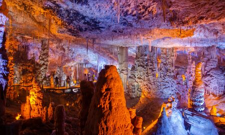 Colorful illuminated stalactites at Stalactites Cave also known as Soreq Cave and Avshalom Cave
