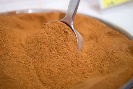 Macroshot of ground nutmeg, sale on local city market
