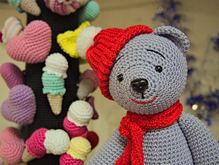 Knitted teddy bear with red hat and scarf toy