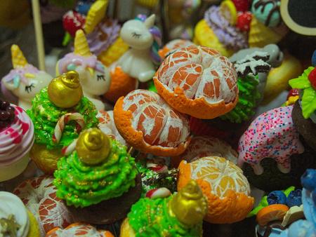 Orange, unicorn, sweets, fruit and ice cream painted plastic figurines
