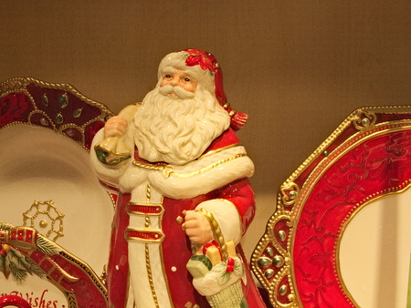 Porcelain holiday Santa Claus figurine, red and white porcelain plates with ornament Stock Photo