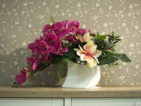 White porcelain vase with flower on a yellow wooden shelf 写真素材