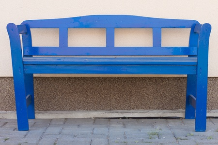 Blue bench in front of a house
