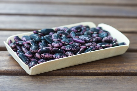 Scarlet runner beans on a wooden table