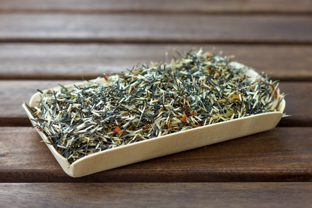 Seeds of tagetes on a wooden table Standard-Bild