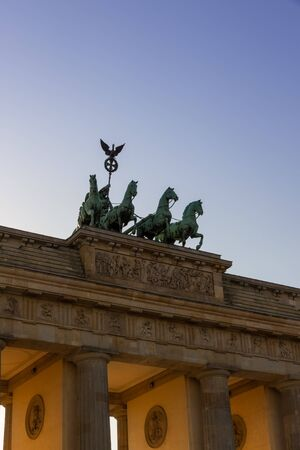 The Brandenburg Gate in Berlin in the sunlight of a warm evening in summer photo