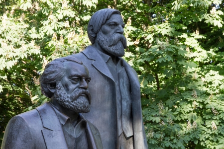 marx: Statue of Karl Marx and Friedrich Engels located in downtown Berlin as a relict of the former German Democratic Republic Stock Photo