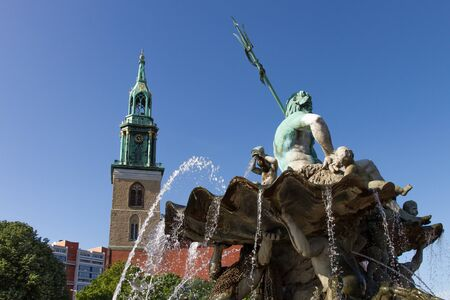 Neptune fountain in front of the St  Mary Church in Berlin