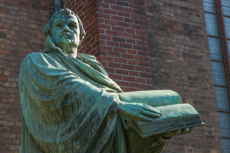 Statue of Martin Luther in front of the St  Mary Church  Marienkirche  in downtown Berlin