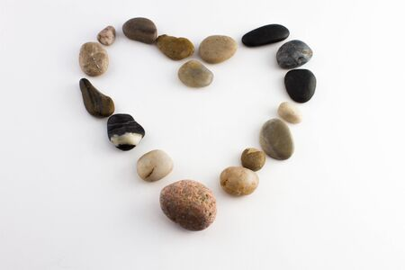 Small stones shaping a heart symbolizing love