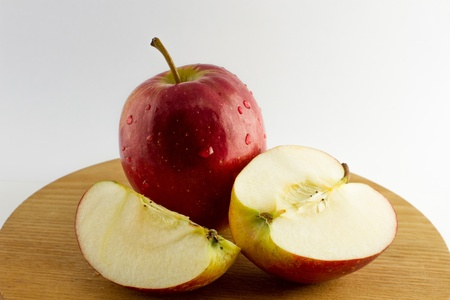 Fresh apples placed on a plate isolated from the background