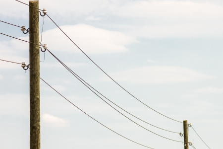 Photo of two old power piles with several copper wires Standard-Bild