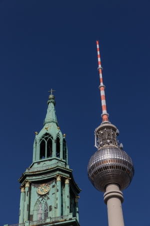 The steeple of St  Mary s church next to Berlin s television tower