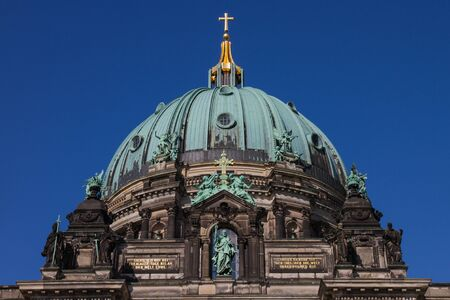 Dome of Berlin Cathedral with golden cross on its top